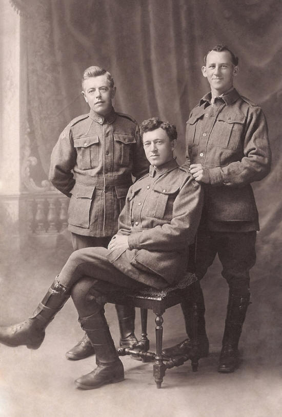 Ned Wells (seated) with two comrades